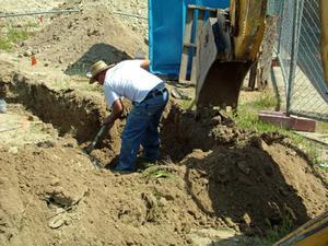 Comment faire pour installer des tuyaux de drainage pour une fosse septique vous