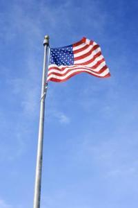 Comment fixer un drapeau à un pôle