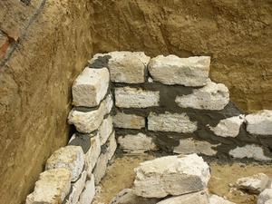 Comment puis-je réparer des murs en pierre dans le sous-sol?