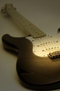 Comment faire pour modifier Cordes sur une Fender Stratocaster