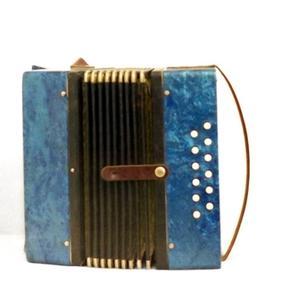Comment jouer le 12 accordéon basses