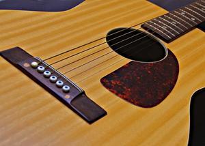 Comment installer micros de transducteurs sur une guitare acoustique