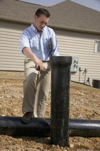 Comment réparer un tuyau d'évacuation en fonte